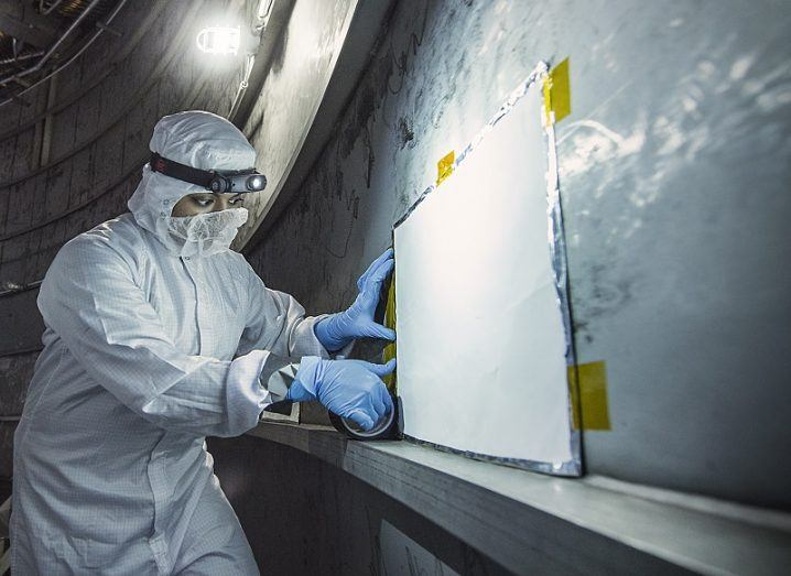 Scientist working in a NASA clean room