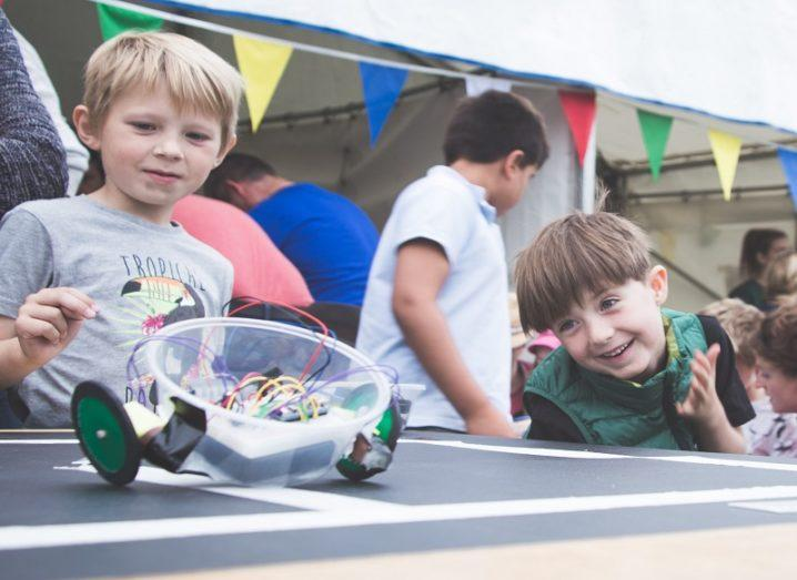 Children playing with robot at Dublin Maker