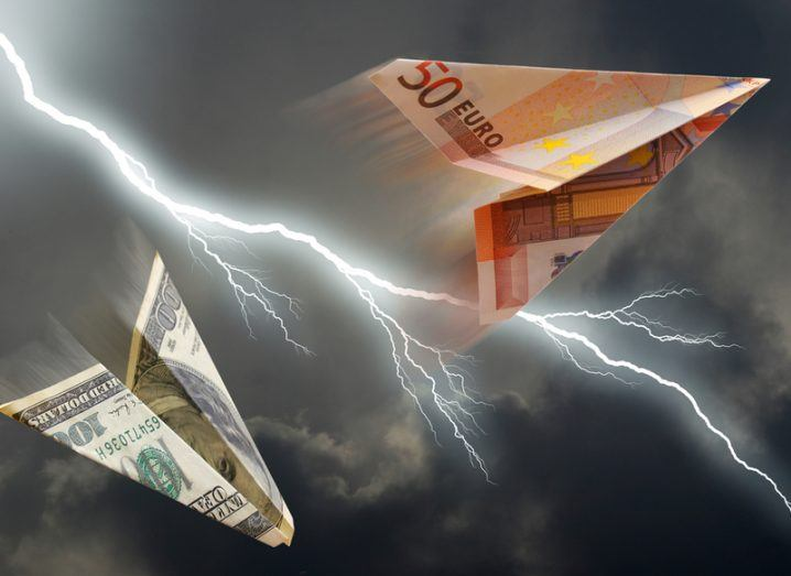 Euro and dollar paper airplanes and a lightning storm