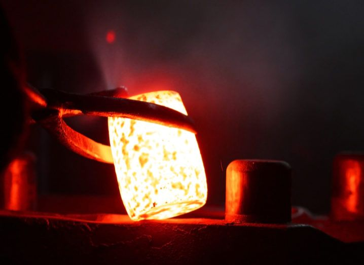 Metal being forged