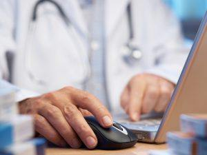 Doctor at computer screen