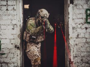 Soldier holding laser weapon