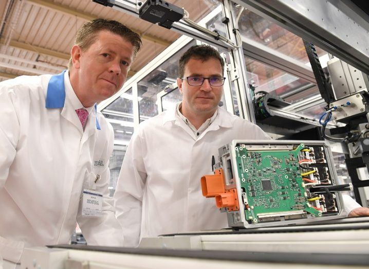 Dr Joseph Walsh and Kieran O'Donoghue holding a motherboard