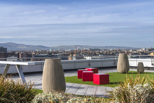 The view into Dublin city, as far as the mountains, from the rooftop garden