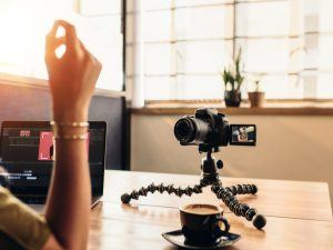 journalist or vlogger recording video for YouTube