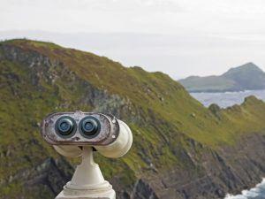 Old tourist telescope on the Irish atlantic coast, view on the cliffs