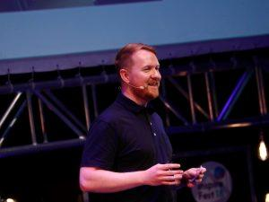 shaun oboyle speaking on stage at inspirefest