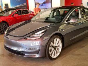 Silver Tesla Model 3 in showroom