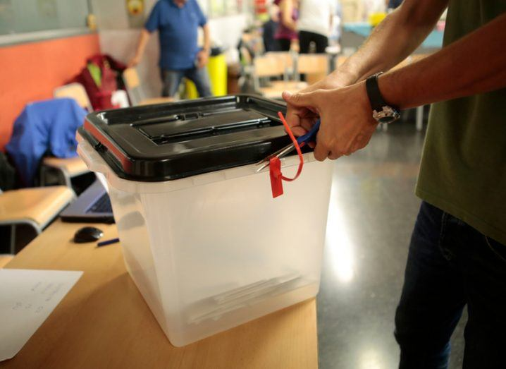 Ballot box in a polling station. Fake news concept