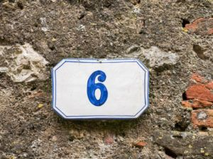 Number 6 on a wall outside a house