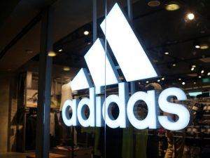 Adidas logo on front of retail store.