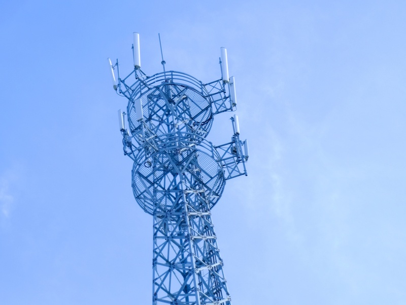 Mobile phone tower against blue sky