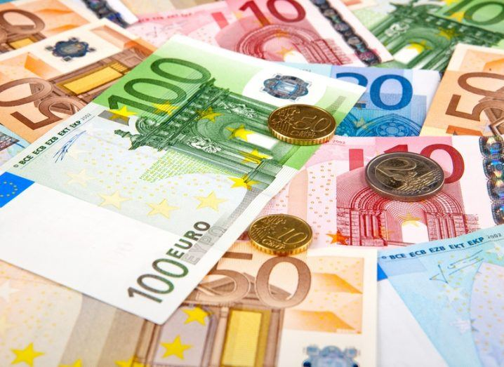 pile of euro notes and coins. TechIreland female-led firms report