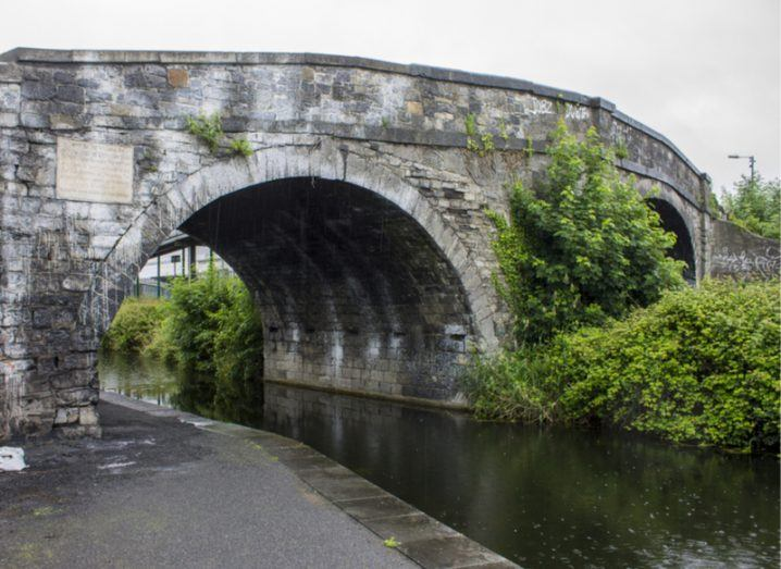 Side view of a stone bridge extending over the Royal Canal, Dublin