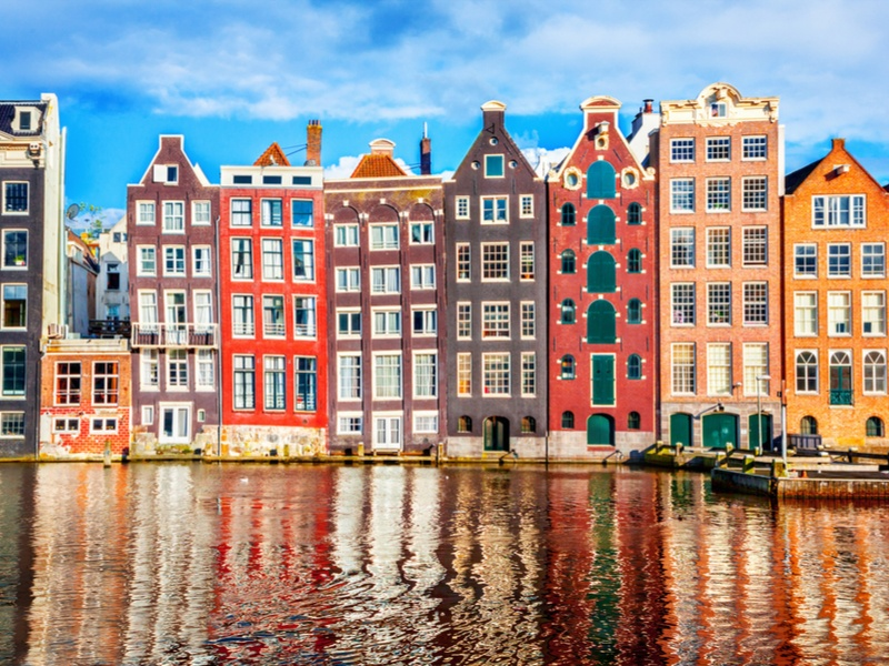 Traditional houses in Amsterdam beside a canal. smart cities