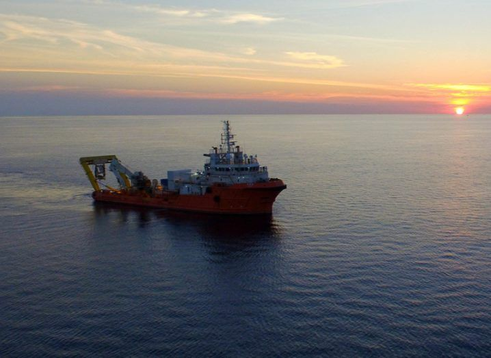subsea cable laying boat on the ocean at sunset