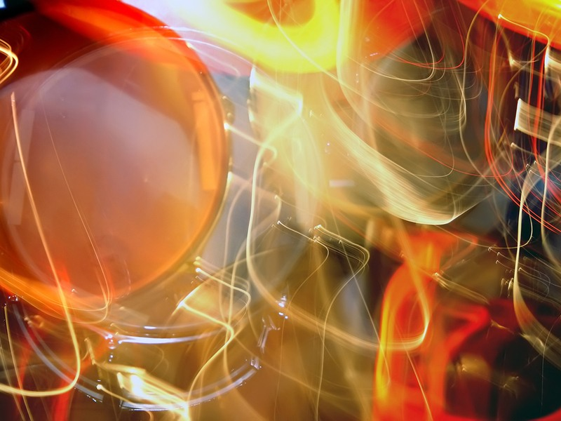 Abstract scene of red, yellow and orange lights chaotically travelling in every direction.