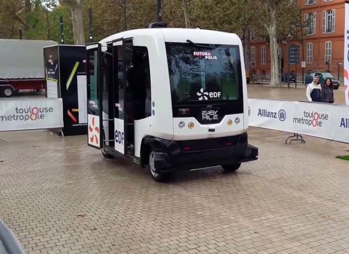 The square EasyMile EZ10 bus on display at an event in Toulouse.