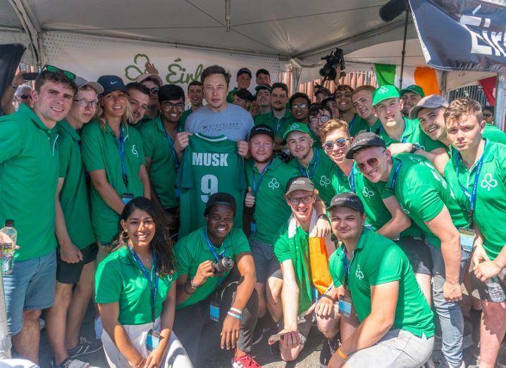 Team Éirloop posing with Elon Musk