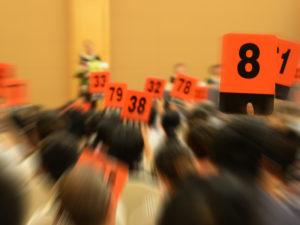 people bidding at an auction