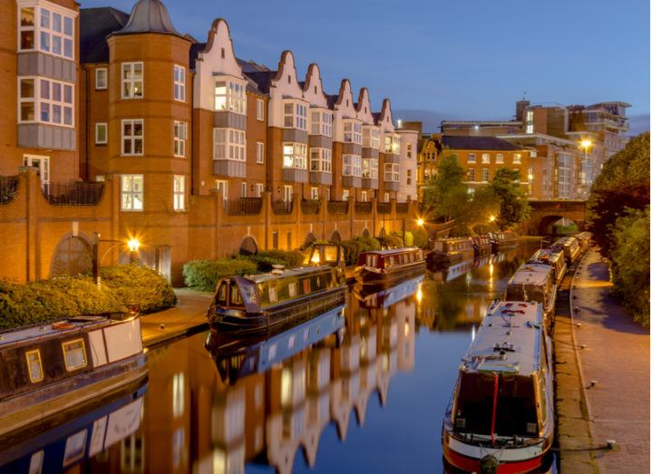 A view of the Birmingham canals with barges.