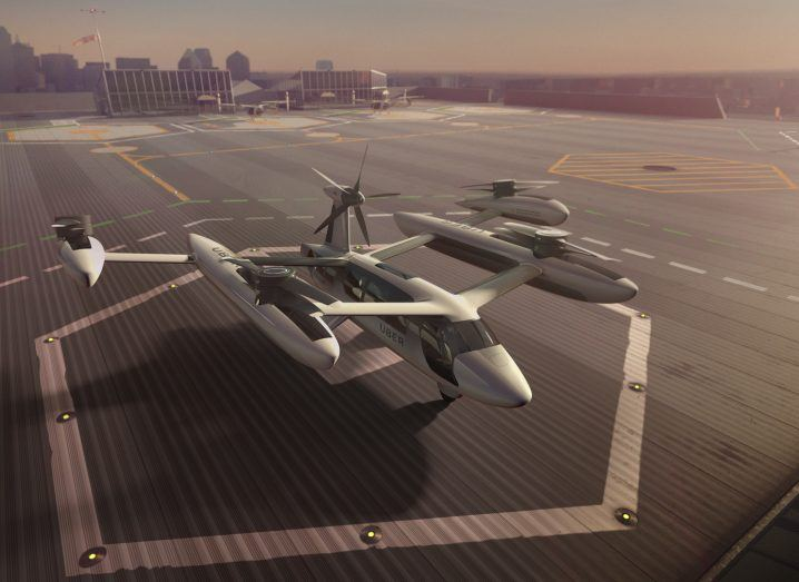 Artists rendering of an Uber flying taxi on a landing pad.