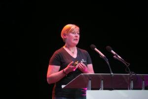 julie gray speaking on stage