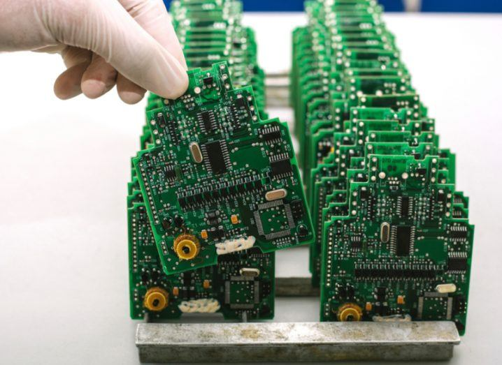 Green circuit boards in a microchip production factory.