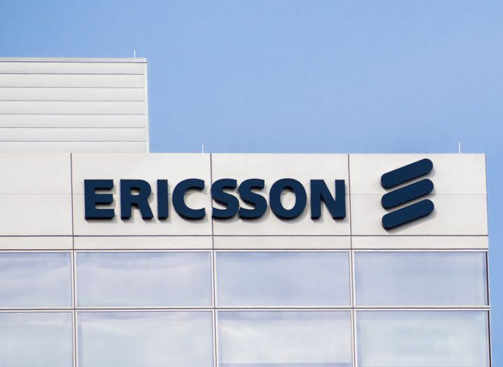 Ericsson sign in dark blue on white building.