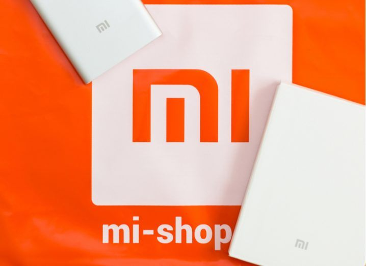 A corporate package bearing the orange Xiaomi logo, with a power bank included.