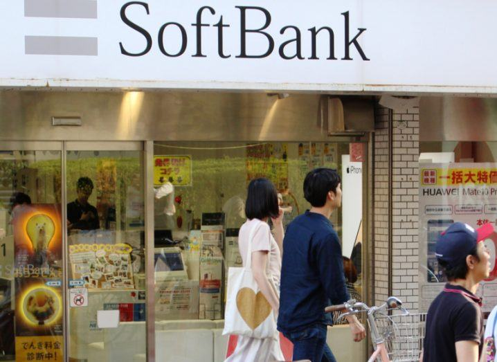 A SoftBank shopfront in Tokyo, with pedestrians passing by.