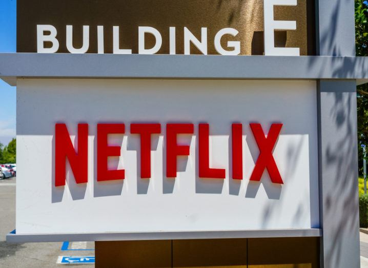 A white sign bearing the Netflix logo outside the company's California office.