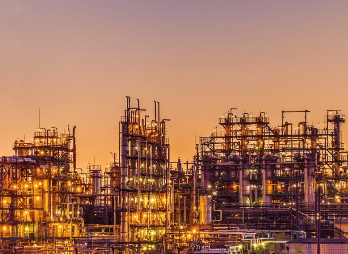An oil refinery at sunset. Cyberattacks on the oil and gas industry are becoming more common.