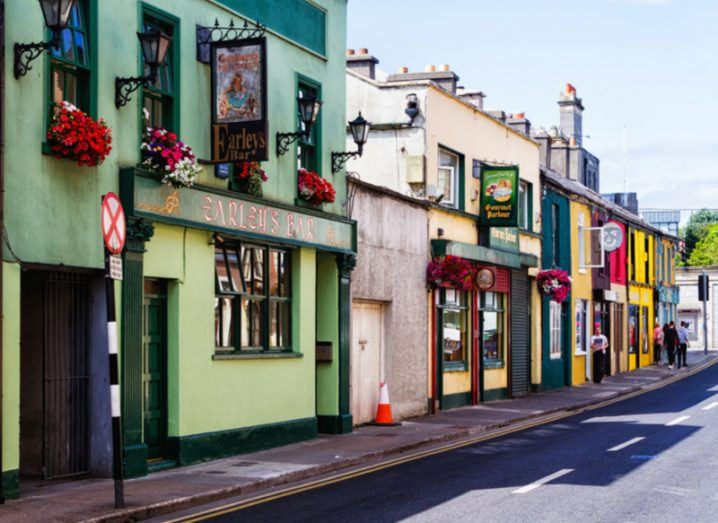A colourful row of storefronts, including a bar and restaurant, in Sligo