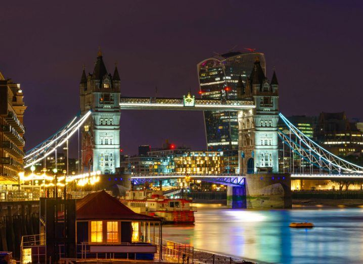 Tower Bridge in London at night. Bright lights over the River Thames.