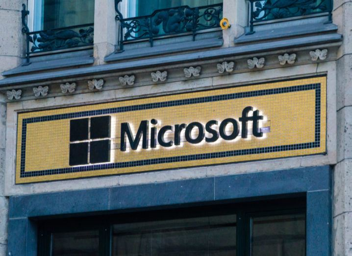 Microsoft shopfront in Berlin. Microsoft logo created with black and gold mosaic tiles.