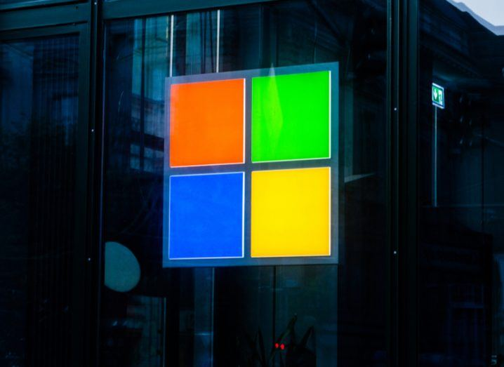 Microsoft Windows logo on front of a building. A blue, red, green and yellow square.