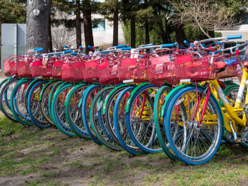 A row of bicycles at the Google offices, painted in red, blue, green and yellow.