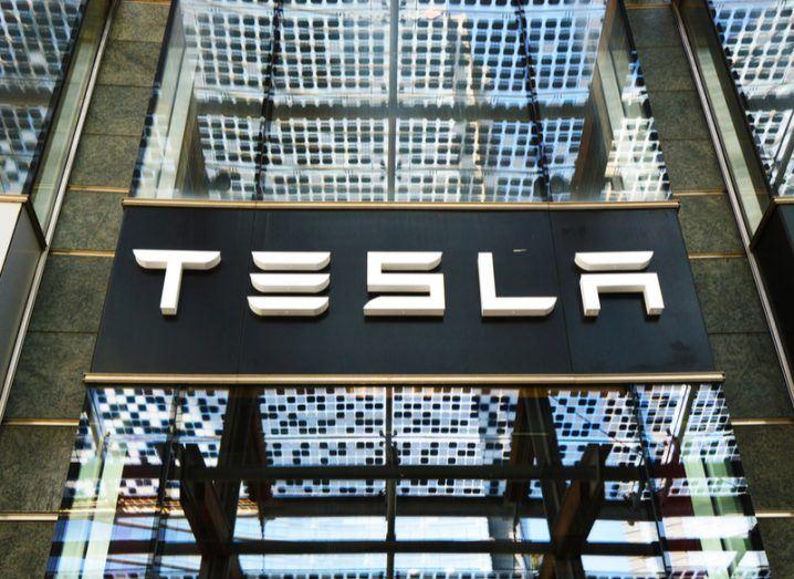 Tesla storefront in Milan, Italy. Tesla logo on glass panels.