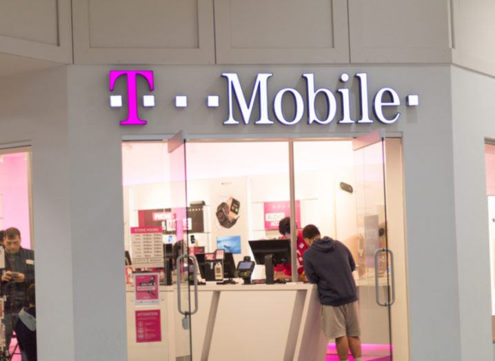 Exterior of a T-Mobile shop in Pennysylvania with customers perusing inside.