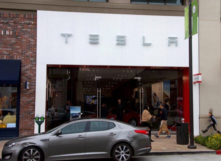 A grey car parked outside a Tesla store in Walnut Creek, California.