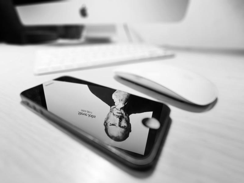 Reflection of Steve Jobs on an iPhone. Image: Stefan Holm/Shutterstock