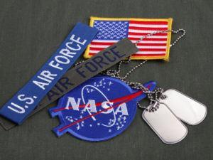 US military and NASA badges. Image: Militarist/Shutterstock
