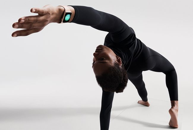 Man doing yoga wearing the new Apple Watch Series 4.