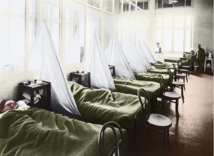 Colourised image of a group of soldiers lying in hospital beds during the 1918-1919 flu epidemic.