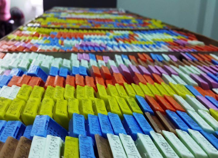 Row of multicoloured clinical files stretching far into the distance.