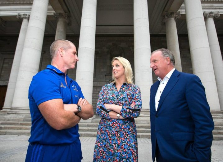 Stuart Lancaster, Anya Cummins and Tom Hayes talking outside a Dublin building.