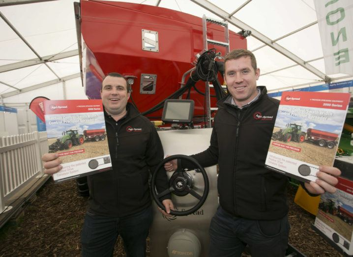 From left: Terry O'Reilly and David Murphy from Agri-Spread smiling in front of their machinery.