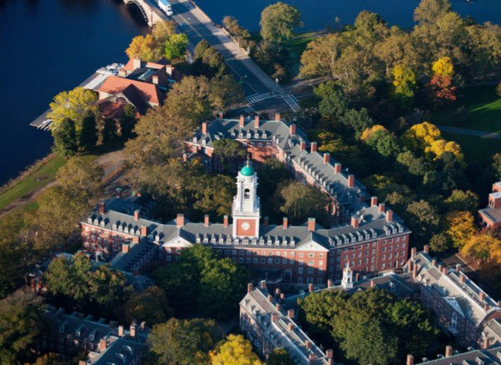 Aerial view of Harvard campus featuring the Eliot House Clock Tower along Charles River.