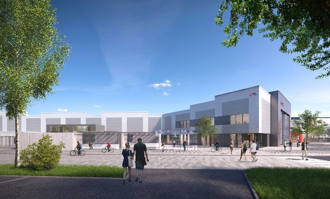 A couple walks in the direction of a shiny new building that will be the new LIT campus at Coonagh, Limerick.
